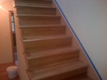 White oak craftsmen style stairs featuring Glitsa Max  satin finish